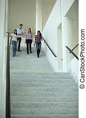 Group of students coming down stairs