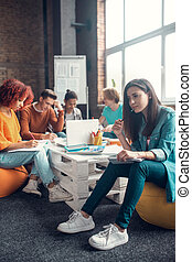 Group of students feeling involved in studying before ...