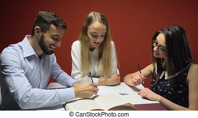 A group of young attractive students have a friendly discussion, teamwork student concept