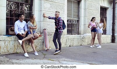 Group of students in front of university taking selfie. -...