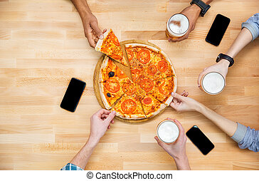 Group of students meeting and eating pizza together