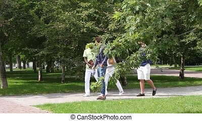 Group of students outdoors studying, walking and looking happy. slow motion