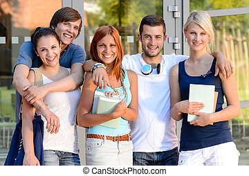Group of students standing front college campus