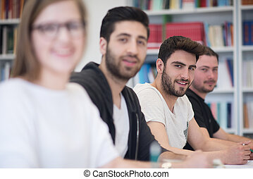 group of students study together in classroom