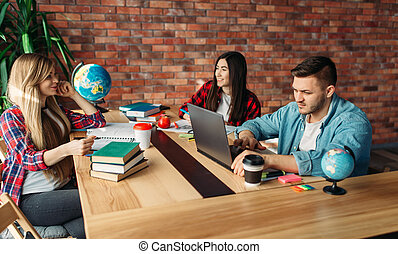 Group of students studying at the table together