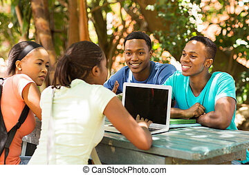 group of students using laptop computer