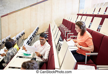 group of students with tests at lecture hall
