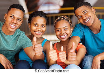 group of students with thumbs up