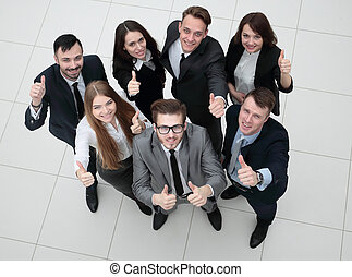 group of successful employees showing thumbs up - concept of...
