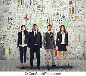 Group of successful men and women business people work on a creative project. Team and corporate concept