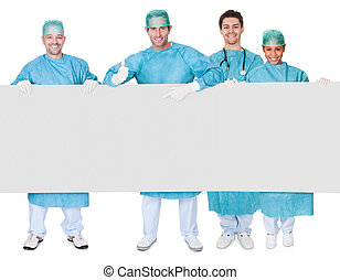 Group of surgeons presenting empty banner