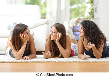 Group of teen friends talking at home