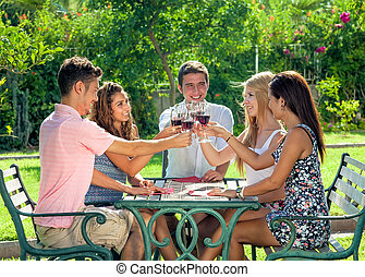 Group of teenage friends enjoying a drink together