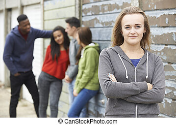 Group Of Teenage Friends Hanging Out In Urban Setting