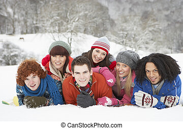 Group Of Teenage Friends Having Fun In Snowy Landscape