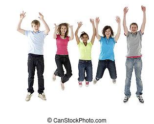 Group of Teenage Friends Jumping in Studio