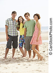 Group Of Teenage Friends Together On Beach