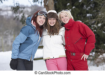 Group Of Teenage Girls In Snowy Landscape