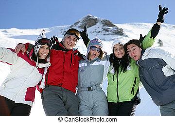 Group of teenage skiers having fun