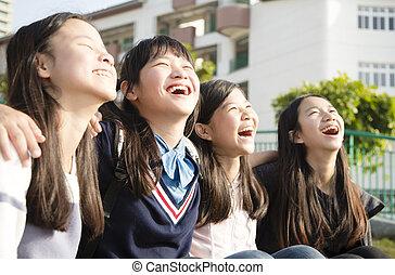 Group Of Teenage Studentshaving fun