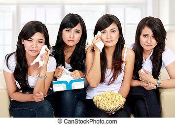 group of teenager watching sad Movie