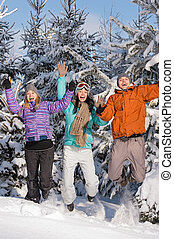 Group of teenagers jumping together in wintertime