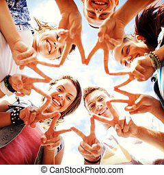 group of teenagers showing finger five