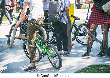 Group of teenagers with bicycles in the Park