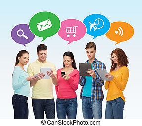 group of teenagers with smartphones and tablet pc - people,...