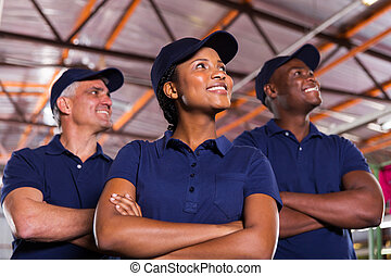 group of textile co-workers looking up
