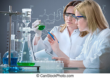 laboratory - group of the students working at the laboratory
