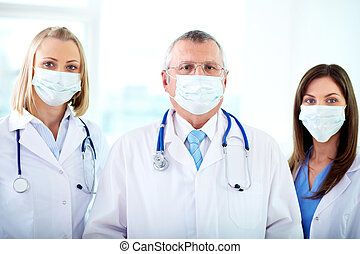 Group of therapeutists - Portrait of three therapeutists in...