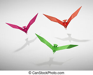 Group of three flying birds in Origami