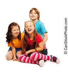 Group of three happy little kids
