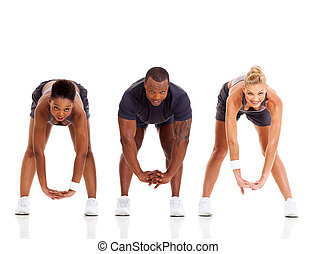 group of three people stretching isolated on white