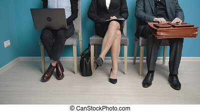 Group of three people waiting in queue line for meeting - ...