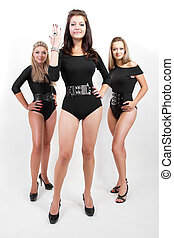 Group of three sexy ladies in black body suits on heels