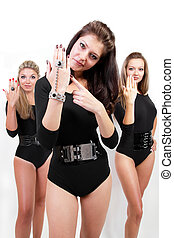 Group of three sexy ladies in black body suits