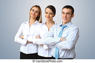 three successful young business persons together