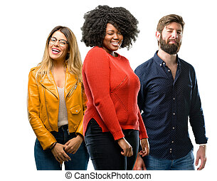Group of three young men and women blinking eyes with happy gesture