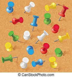 Group of thumbtacks on corkboard