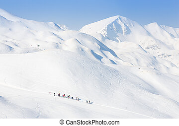 Group of touring skiers on the ski slopes in Alps, Vogel, Slovenia, Europe.