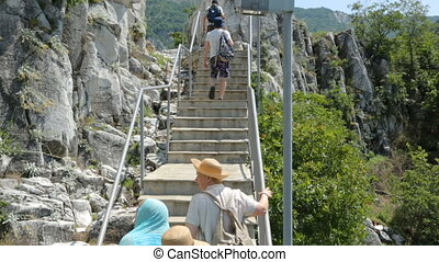 Group of tourist going upstairs