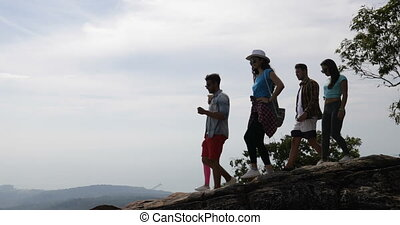 Group Of Tourists On Mountain Top Hold Raised Hands Enjoy Freedom Happy Men And Women Looking At Landscape Skyline In Morning