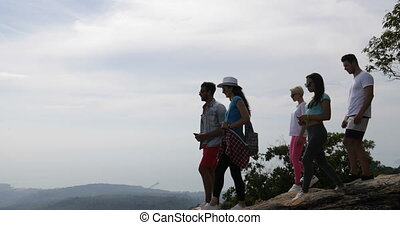 Group Of Tourists On Mountain Top, People Enjoy Landscape With Sunrise Taking Photos On Cell Smart Phone