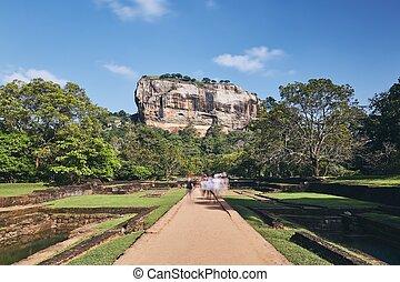 Sigiriya rock in Sri Lanka - Group of tourists walking on ...