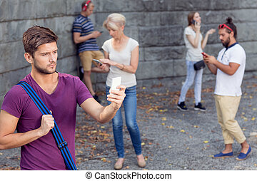 Group of tourists with phones