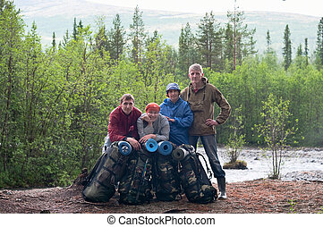 Group of travelers trekking in forest Mountaineering with knapsacks