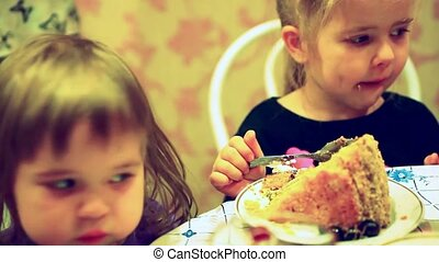 group of two children cute fashion little girls eat happy birthday  cupcake