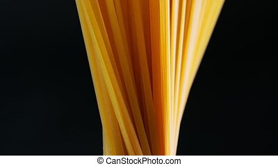 Group of uncooked pasta - uncooked pasta on dark background